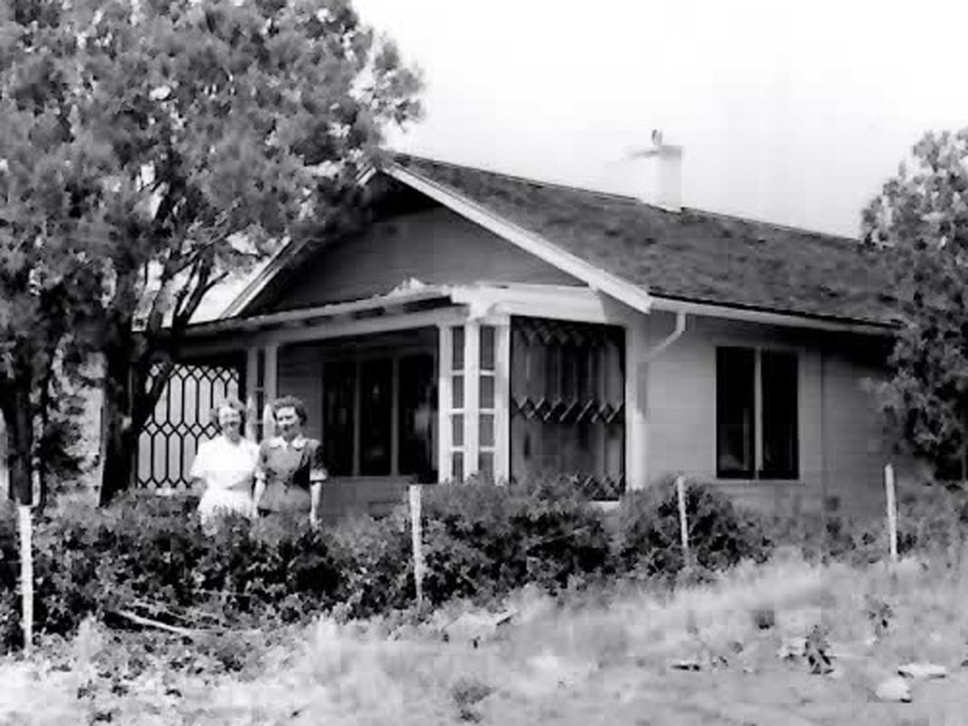 Juniper Hill Cottage with two ladies in the 1940's