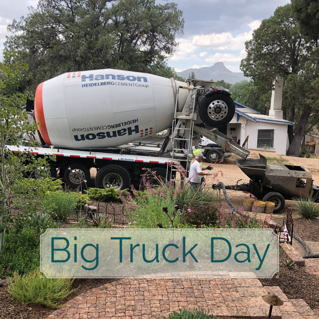 Huge concrete truck pulls up to deliver its load for the foundation