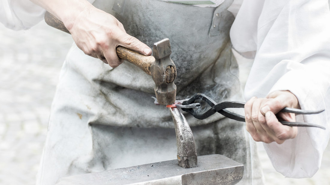 An iron smith at work